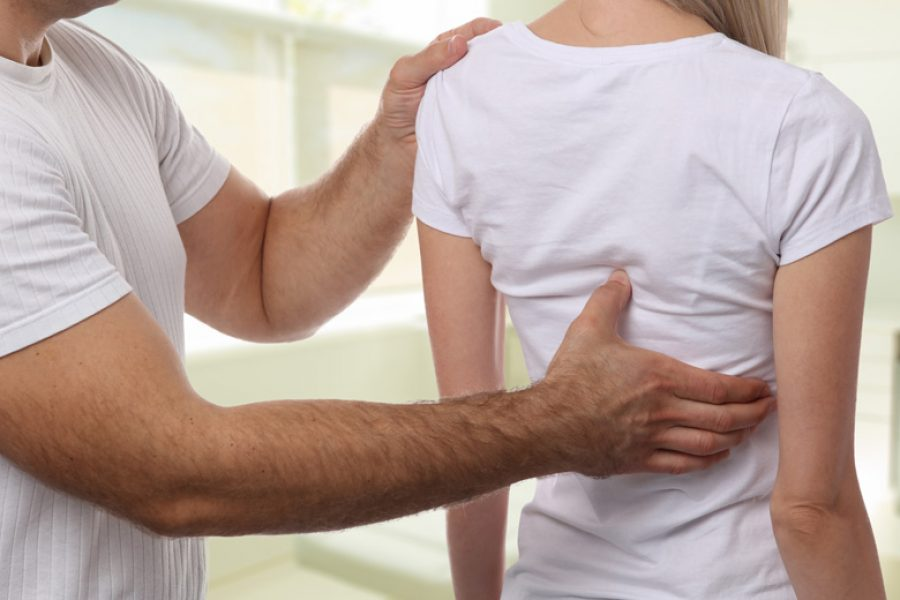 back-pain-osteopathic-adjustment-canberra-best-osteopath-woden-shutterstock_737916013